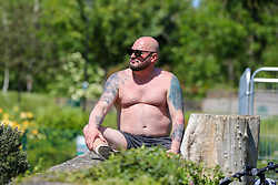 © Licensed to London News Pictures. 20/05/2020. London, UK. A man sunbathes in Markfield Park, Tottenham, north London on a warm and sunny day in London. The government has relaxed the rules on the COVID-19 lockdown, allowing people to spend more time outdoors whilst following social distancing guidelines. According to the Met Office, 27 degrees celsius is forecast for today. <br /> <br /> ***Permission Granted***<br /> <br /> Photo credit: Dinendra Haria/LNP