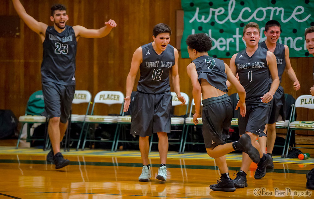 The Liberty Ranch Hawks celebrate winning the game 85-80 at the Placer Hillman in the DIV NorCal boys quarterfinal, Saturday Mar 10, 2018.  <br /> photo by Brian Baer