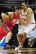 March 23, 2010; Cleveland, OH, USA; New Jersey Nets center Brook Lopez (11) drives past Cleveland Cavaliers center Ryan Hollins (5) during the second quarter at Quicken Loans Arena. Mandatory Credit: Jason Miller-US PRESSWIRE