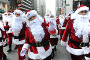 Santas deliver holiday PEEPS and spread cheer throughout New York, Wednesday, Dec. 4, 2013. (Photo by Diane Bondareff/Invision for PEEPS/AP Images)