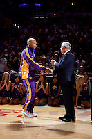 27 October 2009: Guard Derek Fisher of the Los Angeles Lakers shakes Commissioner David Stern's hand during the Los Angeles Lakers ring ceremony before the Lakers 99-92 victory over the LosAngeles Clippers at the STAPLES Center in Los Angeles, CA.