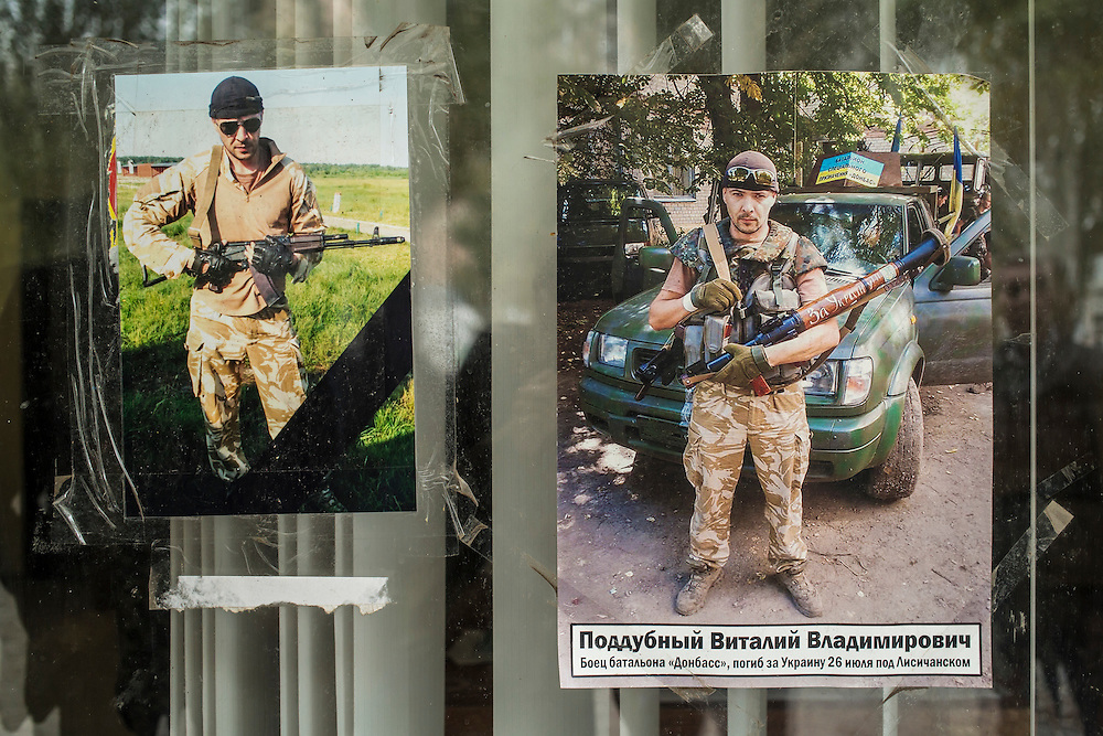 Pictures of two local men who were killed fighting with pro-Ukraine militias in Eastern Ukraine hang on the window of the Berdyansk self-defense force, a local civil guard group, on Wednesday, October 15, 2014 in Berdyansk, Ukraine. Photo by Brendan Hoffman, Freelance