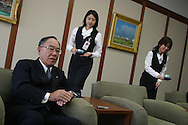 Female employees bring cups of green tea for Fujio Mitarai, President and CEO of Canon Inc., (one of the leading Japanese electronics and camera manufacturing companies), and his guests during an interview, in Tokyo, Japan on Tuesday, Sept. 11th 2004. During interviews it is common for female assistants to enter the rooms silently , bringing refreshment drinks of green tea, coffee, or orange juice, to the company head and his guests.