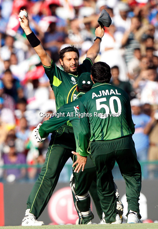 30.03.2011 Cricket World Cup from the Punjab Cricket Association Stadium, Mohali in Chandigarh. India v Pakistan. Shahid Afridi of Pakistan celebrates the wicket of Sachin Tendulkar during the match of the ICC Cricket World Cup between India and Pakistan on the 30th March 2011