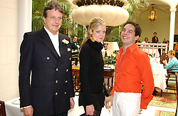 Left to right, LORD VALENTINE CECIL, LADY ELOISE ANSON and jewellery designer LUIS MIGUEL HOWARD at a fashion show of Sybil Stanislaus Summer 2005 collection with jewellery by Philippa Holland held at The Lanesborough Hotel, Hyde Park Corner, London on 13th April 2005.<br />