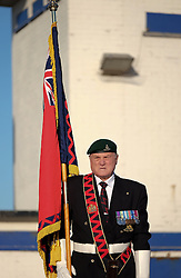 © Licensed to London News Pictures. <br /> 16/12/2014. <br /> <br /> Hartlepool, United Kingdom<br /> <br /> A British Legion standard bearer stands to attention during an event to commemorate the bombardment of Hartlepool by German warships during World War One. During the bombardment 130 civilians were killed and more than 500 were wounded. The Headland's Heugh Gun Battery returned fire in what was the only battle to be fought on British soil during World War One, and one of the Battery's soldiers, Theo Jones of the Durham Light Infantry, became the first British soldier to be killed by enemy action on home ground in the war.<br /> <br /> Photo credit : Ian Forsyth/LNP