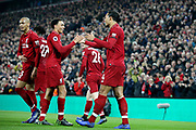 Liverpool defender Virgil van Dijk (4) scores his first goal 4-0 and celebrates with Liverpool defender Trent Alexander-Arnold (66) who gets the assist during the Premier League match between Liverpool and Watford at Anfield, Liverpool, England on 27 February 2019.