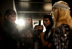 © Licensed to London News Pictures. 21/02/2012. London, UK.  Models being styled and fitted backstage for Aminaka Wilmont Autumn/Winter 2012 collection on day 5 of London Fashion Week 2012, on February 21st, 2012 . Photo credit : Ben Cawthra/LNP