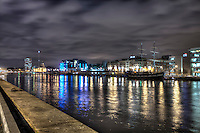 """Dublin at night viewed from the quays. Dublin is the capital and most populous city of Ireland. The English name for the city is derived from the Irish name Dubhlinn, meaning """"black pool"""". Founded as a Viking settlement, it evolved into the Kingdom of Dublin and became the island's principal city following the Norman invasion."""