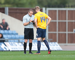 Oxford United's Asa Hall receives a yellow card from referee Stephen Martin  - Photo mandatory by-line: Nigel Pitts-Drake/JMP - Tel: Mobile: 07966 386802 05/10/2013 - SPORT - FOOTBALL - Kassam Stadium - Oxford - Oxford United v Southend United - Sky Bet League 2