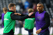 Josh Magennis warming up before the EFL Sky Bet Championship match between Derby County and Hull City at the Pride Park, Derby, England on 18 January 2020.