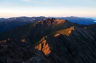 Yushan's (Jade Mountain) Southern Peaks, seen from Jade Mountain Main Peak and lit by a beautiful sunrise.