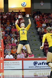 23 October 2010: Mary Elizabeth Hooper floats in the air while setting the ball for Elizabeth Field during an NCAA, Missouri Valley Conference volleyball match between the Wichita State Shockers and the Illinois State Redbirds at Redbird Arena in Normal Illinois.