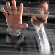 Businessman poses behind plastic wrap - illustration of Corporate Transparency (Model is D.Mciver)