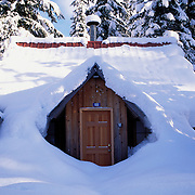 Snow covered cabin in woods, Snoqualmie Pass, Cascade Mountains, Mt. Baker Wilderness, Wenatchee National Forest, Washington State - Property Release IS available