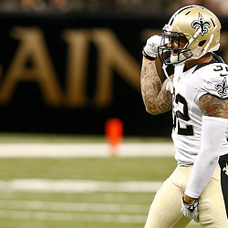 Aug 15, 2014; New Orleans, LA, USA; New Orleans Saints strong safety Kenny Vaccaro (32) reacts during first quarter of a preseason game against the Tennessee Titans at Mercedes-Benz Superdome. Mandatory Credit: Derick E. Hingle-USA TODAY Sports