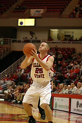 19 November 2005: Brandon Holtz ponders a 3 point attempt, but pulls back and passes in. In a non-conference race that came down to a photo finish, the Illinois State Redbirds slipped past the Indianapolis University Greyhounds 54-50 at Redbird Arena in Normal Illinois