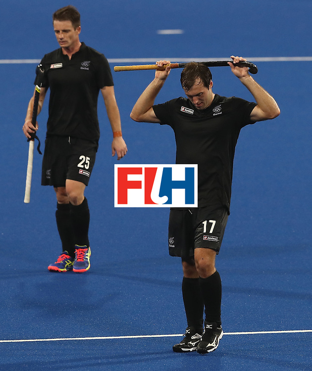 RIO DE JANEIRO, BRAZIL - AUGUST 14:  Nic Woods (R) and Shea McAleese of New Zealand look dejected as they concede a last minute goal as they are defeated 3-2 during the Men's hockey quarter final match between the Germany and New Zealand on Day 9 of the Rio 2016 Olympic Games at the Olympic Hockey Centre on August 14, 2016 in Rio de Janeiro, Brazil.  (Photo by David Rogers/Getty Images)
