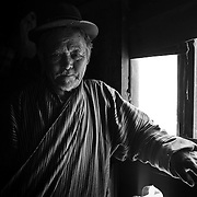 Portrait of a Bhutanese man in his house, Bumthang, Bhutan, Asia