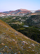 The sun rises on Mount Rearguard in the Absaroka-Beartooth Wilderness, and over Hellroaring Creek; Custer National Forest, near Red Lodge, Montana.