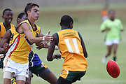 POTCHEFSTROOM, SOUTH AFRICA - JANUARY 28, Russell Wynne (Mount Barker, WA) of the Australian Boomerangs and Atang Moshoeshoe (WC Magpies) of the SA Lions during the AFL Game 1 match between the Flying Boomerangs and South African Lions under 18's at Mohadin Cricket Ground on January 28, 2013 in Potchefstroom, South Africa.Photo by Roger Sedres / Image SA