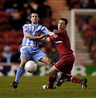 Photo: Jed Wee.<br /> Middlesbrough v Coventry City. The FA Cup. 08/02/2006.<br /> <br /> Middlesbrough's Doriva (R) feels the force of a clash with Coventry's Michael Doyle.