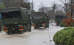 Army trucks on call after flooding from the Heathcote River, Christchurch, New Zealand, Saturday, July 22, 2017. Credit:  SNPA / David Alexander -NO ARCHIVING-