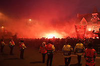 Football - 2019 / 2020 UEFA Champions League - Round of Sixteen, Second Leg: Liverpool (0) vs. Atletico Madrid (1)<br /> <br /> Liverpool fans let off flares as the Liverpool team coach arrives, at Anfield.<br /> <br /> <br /> COLORSPORT/TERRY DONNELLY