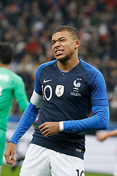 France's Kylian Mbappe feels a pain in his shoulder during France v Uruguay friendly football match at the Stade de France in Saint-Denis, suburb of Paris, France on November 20, 2018. France won 1-0. Photo by Henri Szwarc/ABACAPRESS.COM
