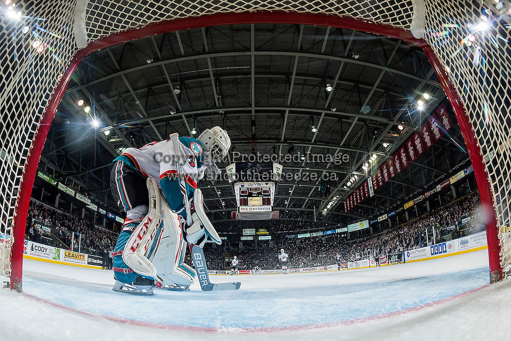 KELOWNA, CANADA - MARCH 4: Michael Herringer #30 of the Kelowna Rockets clears snow from the crease against the Tri-City Americans on March 4, 2017 at Prospera Place in Kelowna, British Columbia, Canada.  (Photo by Marissa Baecker/Shoot the Breeze)  *** Local Caption ***