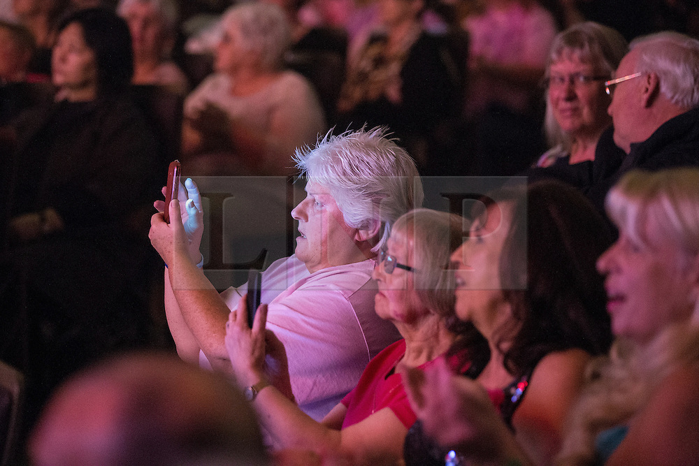 © Licensed to London News Pictures . 04/10/2015 . Manchester , UK . The crowd take photos of Sir Cliff Richard on their phones as he performs at the Bridgewater Hall in Manchester . Photo credit: Joel Goodman/LNP