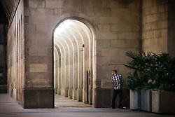© Licensed to London News Pictures . Manchester , UK . 05/04/2015 . A man urinates in a corner , against Manchester Town Hall . Revellers on a Saturday night out during the Easter Bank Holiday weekend . Photo credit : Joel Goodman/LNP