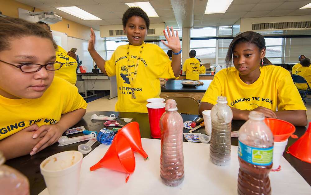 Students conduct experiments during a summer STEM camp at MC Williams Middle School, June 25, 2015.