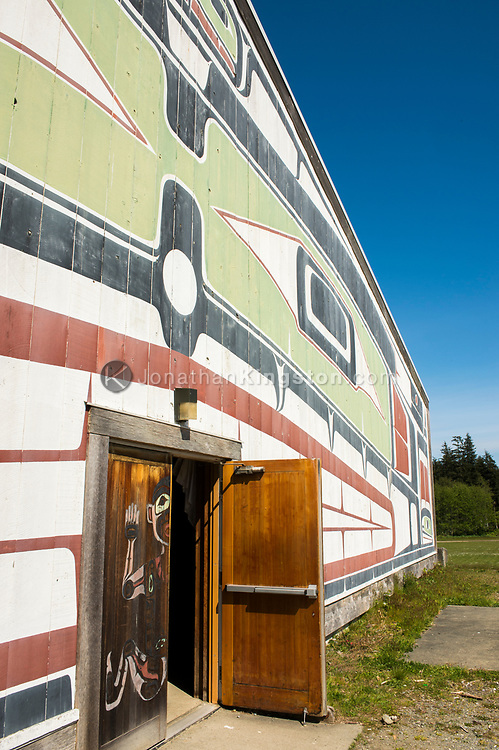 Ornately painted wall and front entrance to a first nations Big House.