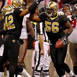 January 2, 2011; New Orleans, LA, USA; New Orleans Saints linebacker Jo-Lonn Dunbar (56) celebrates with teammates following a fumble recovery against the Tampa Bay Buccaneers during the fourth quarter at the Louisiana Superdome. The Buccaneers defeated the Saints 23-13. Mandatory Credit: Derick E. Hingle