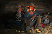 Ecuadorian Chagras (cowboys) relaxing after day's work<br /> Yanahurco Hacienda (Ranch) - largest privately owned ranch in Ecuador (25.000 hectares)<br /> base of Cotopaxi Volcano<br /> Andes<br /> ECUADOR.  South America