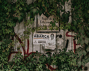 "Here a campaign poster of Jose Luis Abarca, the former mayor of Iguala who ordered the attack on the students, on a abandoned building in Iguala. The sign's campaign slogan reads ""closer to you."" Abarca has since been arrested and has been charged with, among other things, links to organized crime."