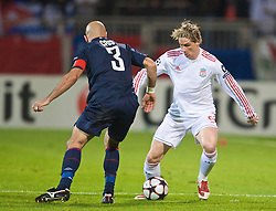 LYON, FRANCE - Wednesday, November 4, 2009: Liverpool's Fernando Torres takes on Olympique Lyonnais' Cris during the UEFA Champions League Group E match at Stade Gerland. (Pic by David Rawcliffe/Propaganda)