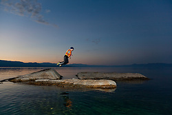 """Boy at Lake Tahoe 2"" - This boy was photographed near Speedboat Beach, Lake Tahoe,  jumping from rock to rock at sunrise."