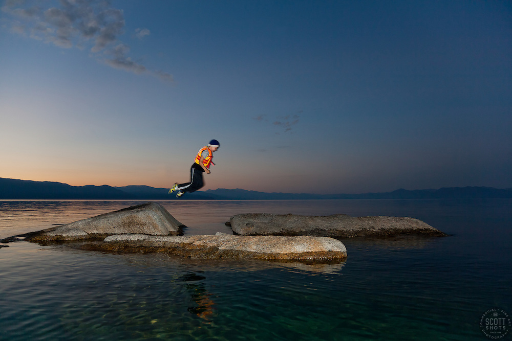 """""""Boy at Lake Tahoe 2"""" - This boy was photographed near Speedboat Beach, Lake Tahoe,  jumping from rock to rock at sunrise."""