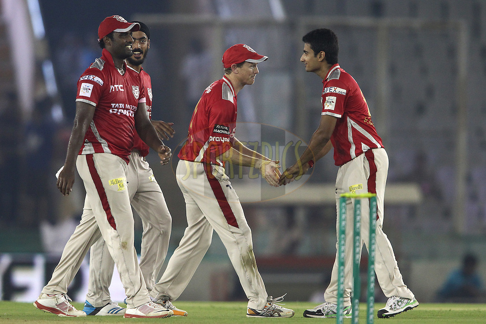 Kings XI Punjab captain George Bailey and Karanveer Singh of the Kings XI Punjab celebrate getting Shoaib Malik of the Hobart Hurricanes wicket during match 2 of the Oppo Champions League Twenty20 between the Kings XI Punjab and the Hobart Hurricanes held at the Punjab Cricket Association Stadium, Mohali, India on the 18th September 2014<br /> <br /> Photo by:  Shaun Roy / Sportzpics/ CLT20<br /> <br /> <br /> Image use is subject to the terms and conditions as laid out by the BCCI/ CLT20.  The terms and conditions can be downloaded here:<br /> <br /> http://sportzpics.photoshelter.com/gallery/CLT20-Image-Terms-and-Conditions-2014/G0000IfNJn535VPU/C0000QhhKadWcjYs