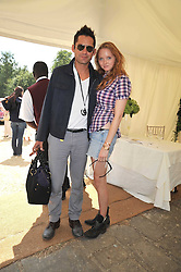LILY COLE and ENRIQUE MURCIANO at a luncheon hosted by Cartier for their sponsorship of the Style et Luxe part of the Goodwood Festival of Speed at Goodwood House, West Sussex on 5th July 2009.