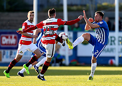 Carl Magnay of Hartlepool United tackles Conor Grant of Doncaster Rovers - Mandatory by-line: Robbie Stephenson/JMP - 06/05/2017 - FOOTBALL - The Northern Gas and Power Stadium (Victoria Park) - Hartlepool, England - Hartlepool United v Doncaster Rovers - Sky Bet League Two