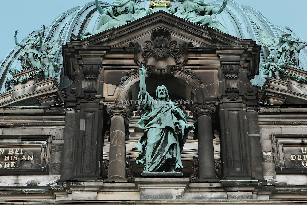 Statue of Christ raising arm in blessing below the dome of the Berliner Dom or Berlin Cathedral, redesigned by Julius Raschdorff and completed 1905 in Historicist style after being badly damaged in World War Two, although the original chapel on this site was consecrated in 1454, Museum Island, Mitte, Berlin, Germany. The buildings on Museum Island were listed as a UNESCO World Heritage Site in 1999. Picture by Manuel Cohen