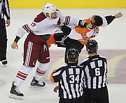 Flyers' Zac Rinaldo gets punched by Coyotes' Paul Bissonnette while fighting during the first period at the Wells Fargo Center in Philadelphia.