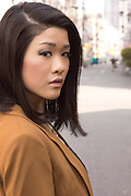 Young Japanese woman in the streets of Osaka.