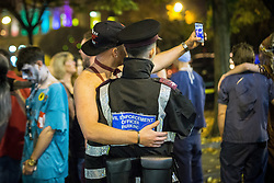 © Licensed to London News Pictures . 01/11/2015 . Manchester , UK . A traffic warden poses for a selfie with a reveller . Halloween revellers , wearing make up and costumes , out and about in Manchester City Centre . Photo credit : Joel Goodman/LNP