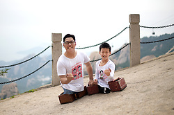 QINGDAO, CHINA - SEPTEMBER 10: ..Legless motivational speaker Chen Zhou (R) and legless teenager Gao Zhiyu climb the Mount Lao on September 10, 2016 in Qingdao, Shandong Province of China. 11-year-old Gao Zhiyu form Shandong Jimo, accompanied by 32-year-old motivational speaker Chen Zhou form Shandong Linyi, climbed the Mount Lao and finally arrived at the 900-meter-high site after over five hours\' climbing on Saturday in Qingdao. .©Exclusivepix Media (Credit Image: © Exclusivepix media via ZUMA Press)