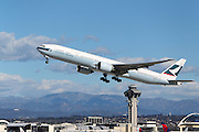 LOS ANGELES, CALIFORNIA, USA - JANUARY 28, 2013 - Cathay Pacific Boeing 777-367(ER) takes off from Los Angeles Airport on January 28, 2013. The plane has the most powerful jet engines in commercial service
