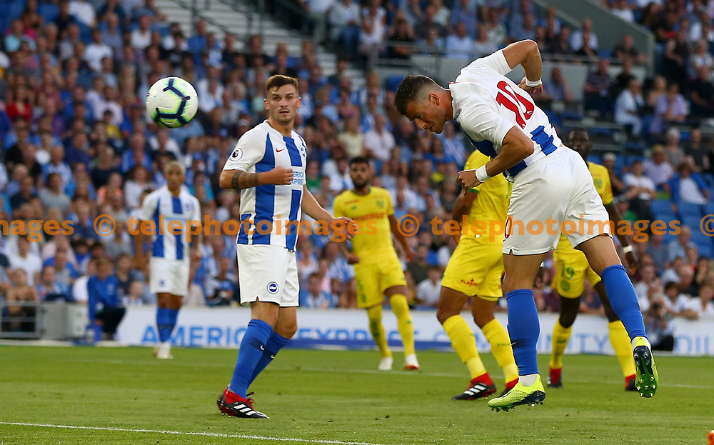 Tomer Hemed of Brighton header is saved by Ciprian Tatarusanu of FC Nantes during the pre season friendly between Brighton and Hove Albion and FC Nantes at the American Express Community Stadium in Brighton. 03 Aug 2018